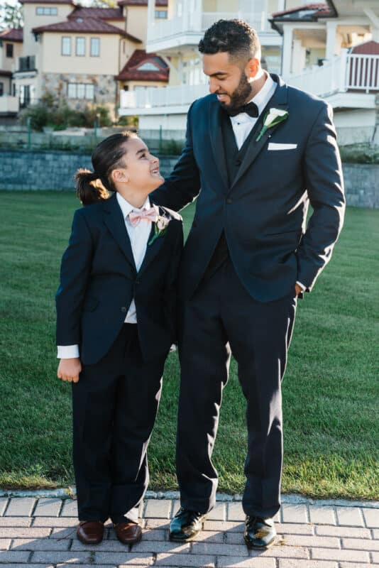 Groom poses with ring bearer before a Hudson Valley Wedding at Green Tree Country Club in New Rochelle