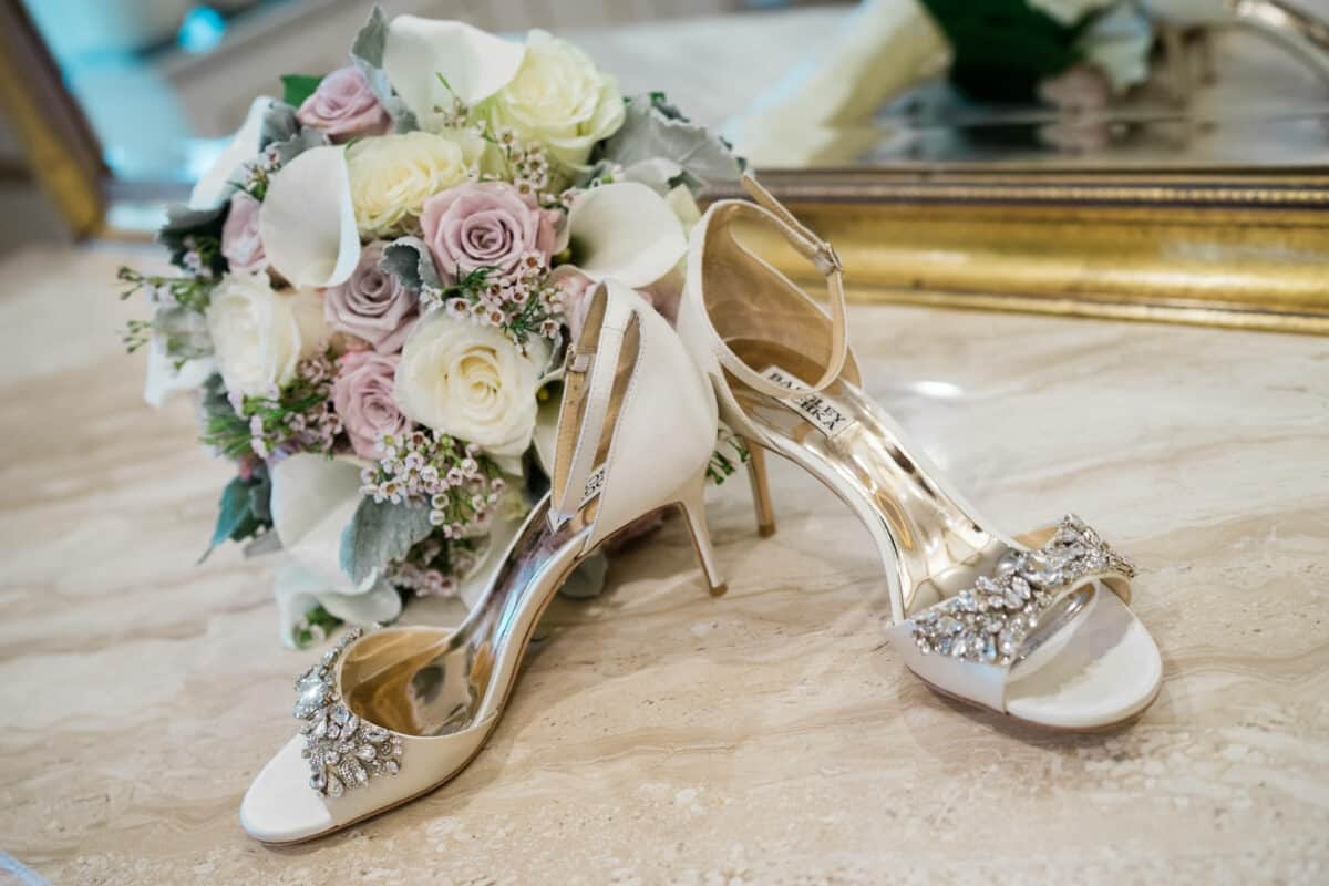 Brides wedding shoes and bouquet before a Hudson Valley Wedding at Green Tree Country Club in New Rochelle