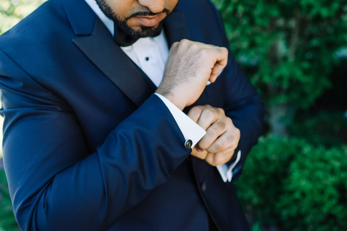 Groom checks cuff links before a Hudson Valley Wedding at Green Tree Country Club in New Rochelle