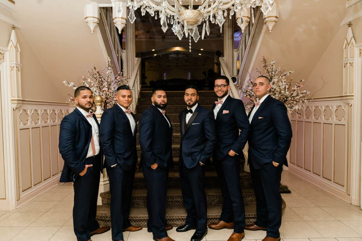 Groom poses with groomsen before a Hudson Valley Wedding at Green Tree Country Club in New Rochelle