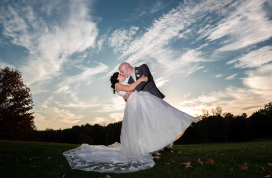 Groom dips bride for a photo at a Hudson Valley Wedding At West Hills Country Club In Middletown, New York