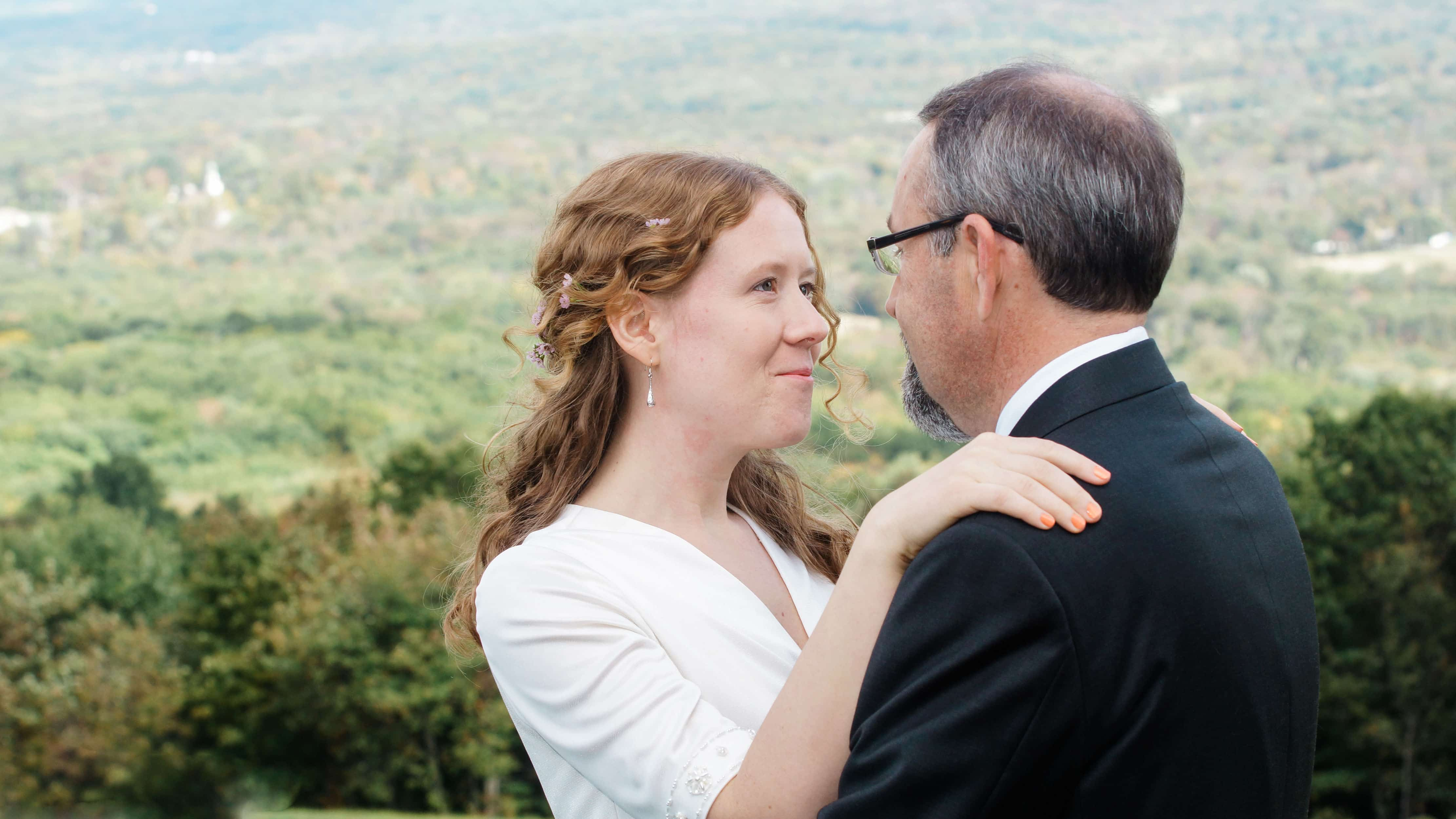 Brides looks into grooms eyes by Valley before ceremony at a Eagles Nest Wedding in the Hudson Valley