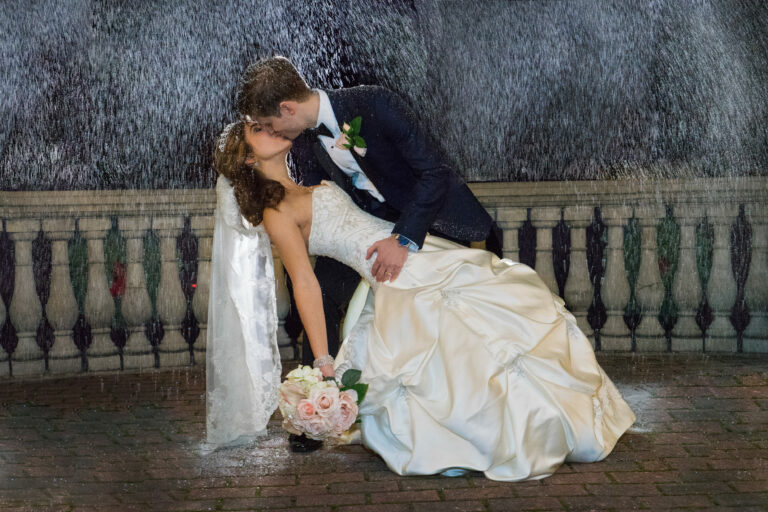 Groom dips and kisses bride in snow at a Villa Borghese Wedding in the Hudson Valley