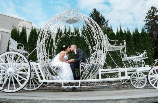 Bride and groom kiss in metal carriage at Hudson Valley Wedding at Anthony's Pier 9