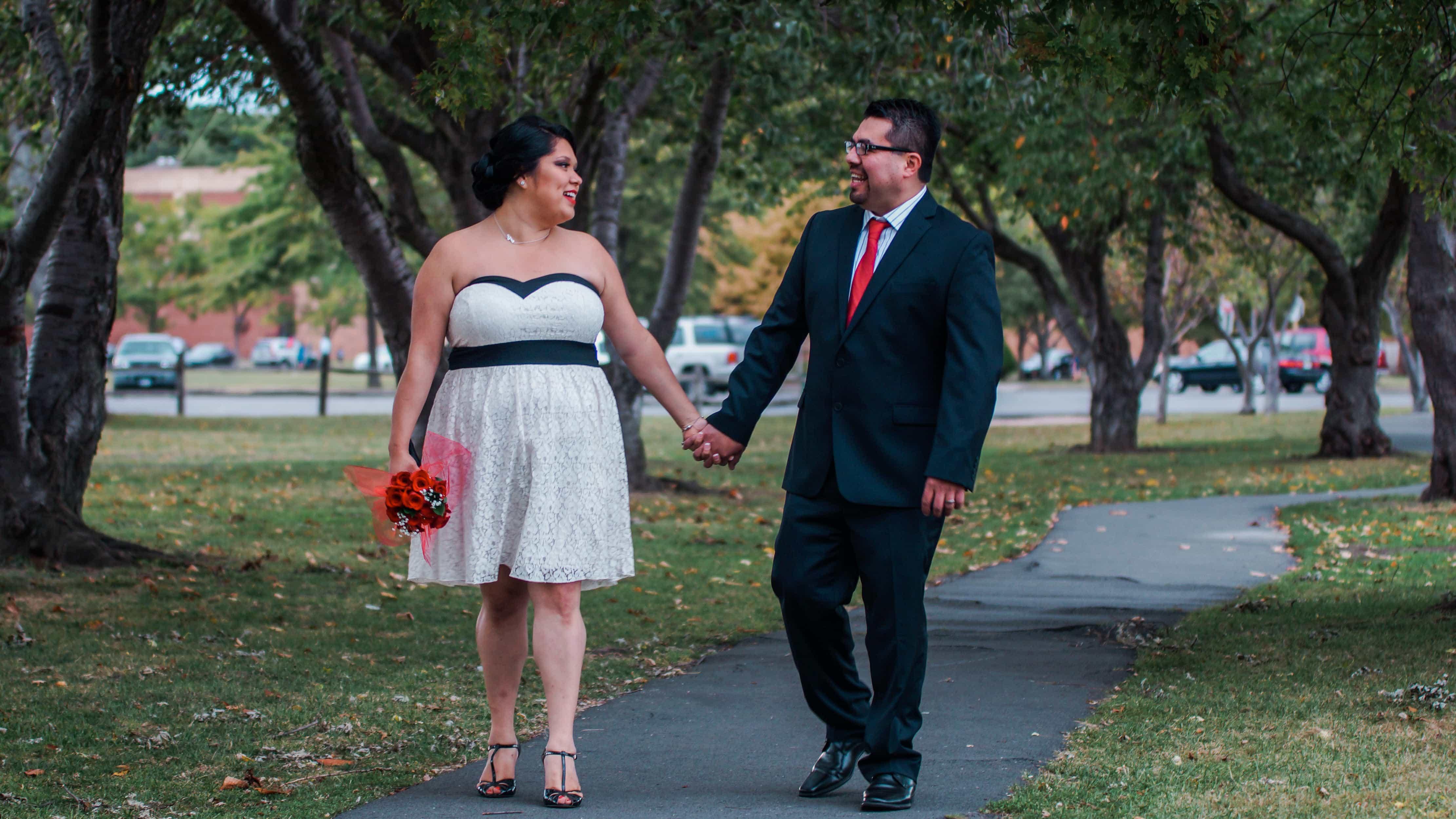 Bride and Groom walk through tree path at Harbor Island Park Wedding in Westchester