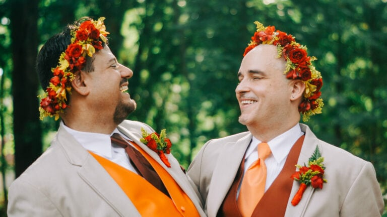 Groom looks into grooms eyes at a wedding at Morristown Unitarian Fellowship