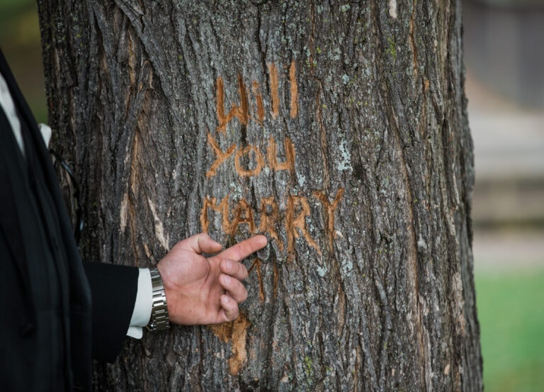 Groom carves note in tree before a Anthonys Pier Nine Wedding in the Hudson Valley