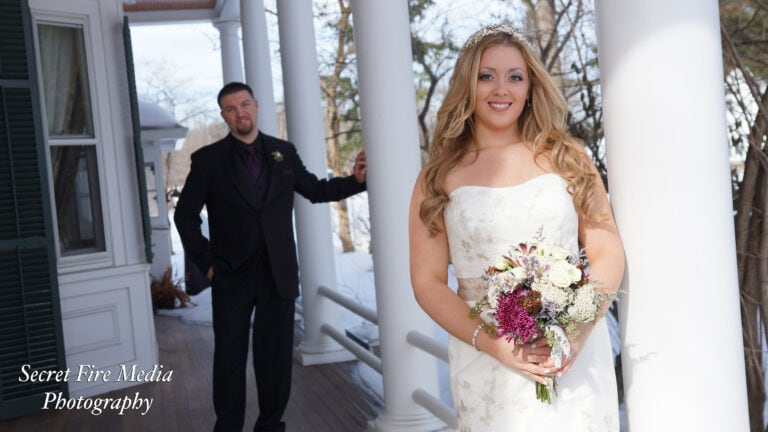 Bride and Groom pose on porch before a Hudson Valley wedding at The Caldwell House