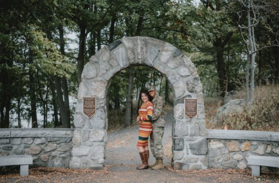 Bride and groom pose by Flirtation Walk Arch for West Point Engagement Photography