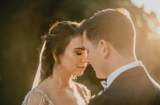 Bride and Groom touch foreheads by Hudson River at Sunset at a Hudson Valley Wedding for Locust Grove Estate Wedding Photography