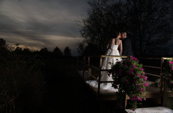 Bride and Groom kiss for photo on rustic cart at a Hudson Valley Wedding At Lippincott Manor in Walkill New York