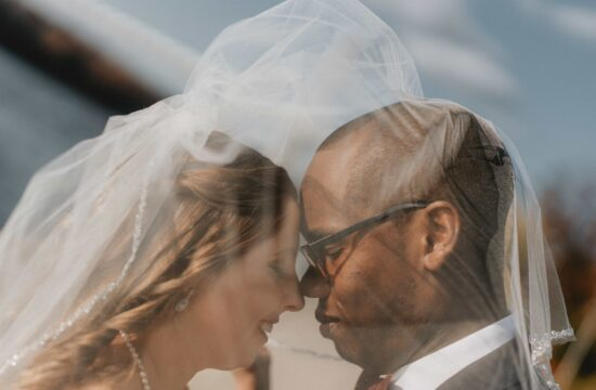 Bride and Groom touch foreheads underneath veil at a Hudson Valley Wedding at The Grandview in Poughkeepsie