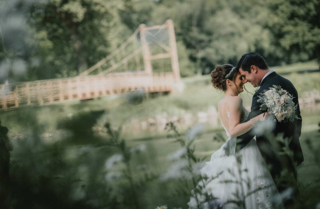 Bride and Groom touch foreheads at a Hudson Valley Wedding at West Hills Country Club in Middletown New York