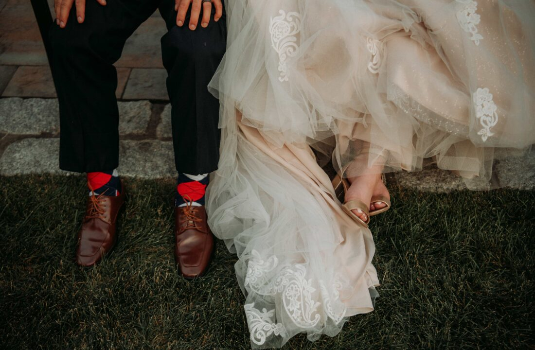 Bride and grooms shoes by lake at a Hudson Valley Wedding at Villa Barone Hilltop Manor in Mahopac