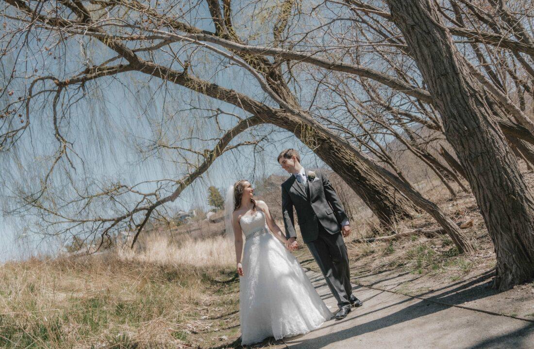 Bride and Groom walk along path at a Hudson Valley Wedding at Villa Borghese