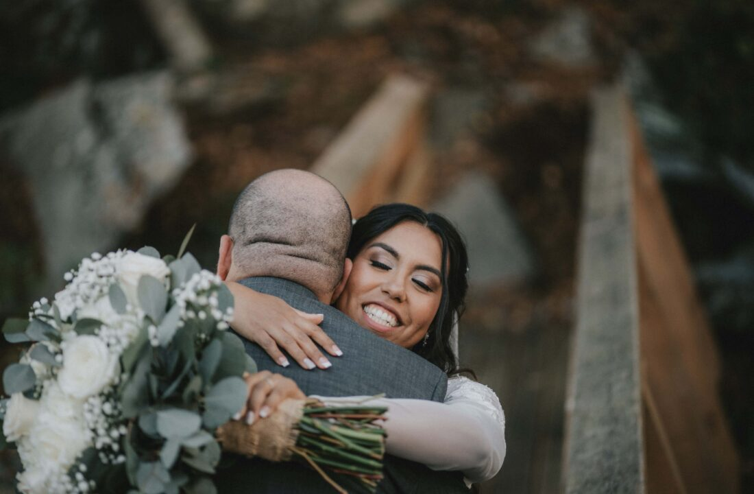 Bride and Groom hug on bridge at a Hudson Valley Wedding at The Wager House