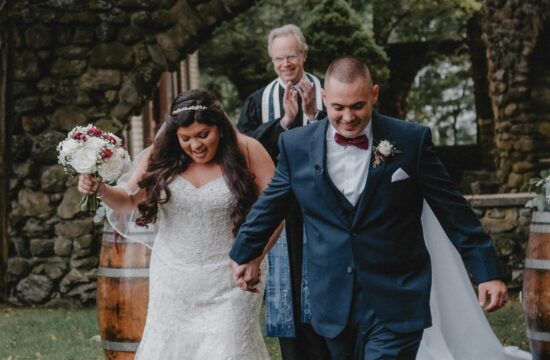 Bride and Groom walk down aisle during Ceremony at a Hudson Valley Wedding at Brotherhood Winery