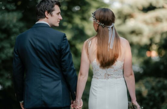 Bride and Groom hold hands at a Backyard Micro Wedding in Trumbull Connecticut