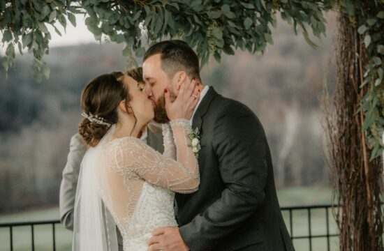 Bride and Grooms first kiss during ceremony at a Hudson Valley Wedding at Hollow Brook Country Club